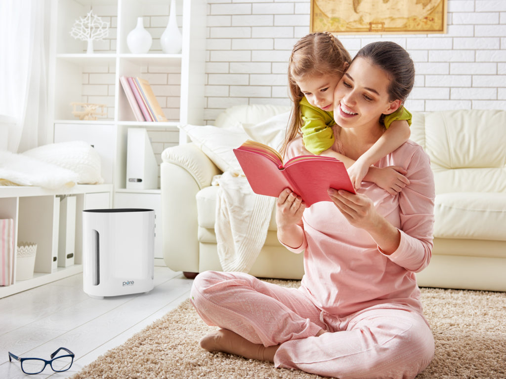Best Air Purifier for a Baby's Room Header Image - Mother reading a book to her child